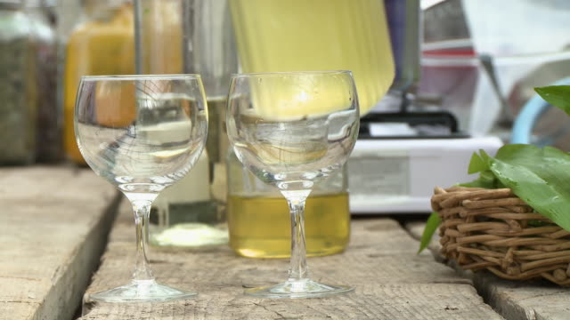 pouring wine into a wine glass - jug stock videos & royalty-free footage