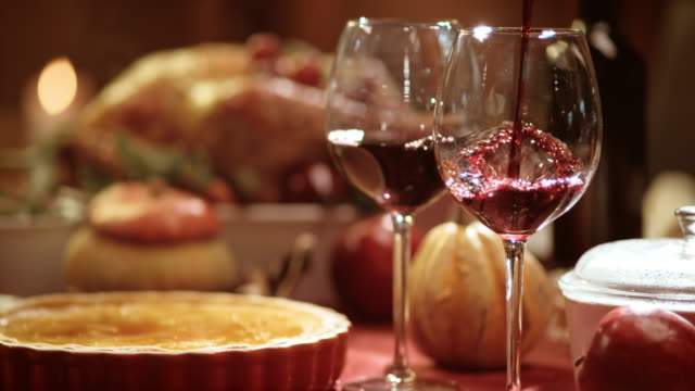 slo mo pouring wine into the glass at thanksgiving table - wine stock videos & royalty-free footage