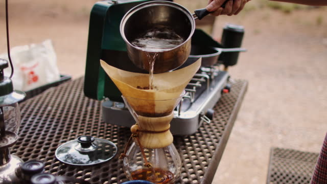 pour-over coffee in campsite - table top shot stock videos and b-roll footage