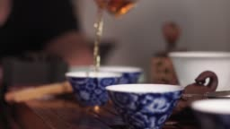 pours hot tea, a Chinese ceremony selective focus.