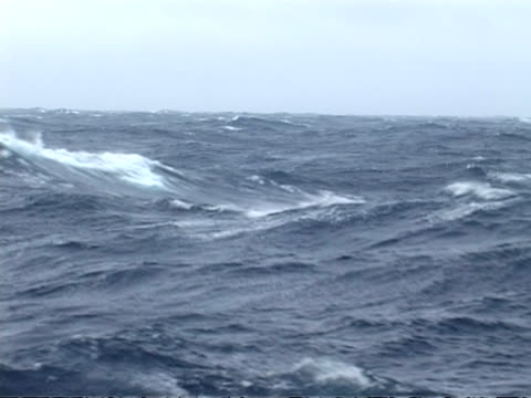 wa pov boat, rough sea, undulating water heaves, white spray blows off crests of waves in wind, grey sky, drake passage, antarctica - drake passage stock videos and b-roll footage
