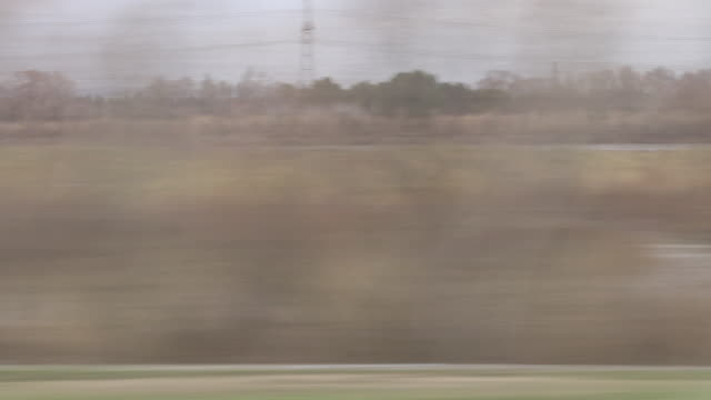 Pov landscape seen through window of moving train