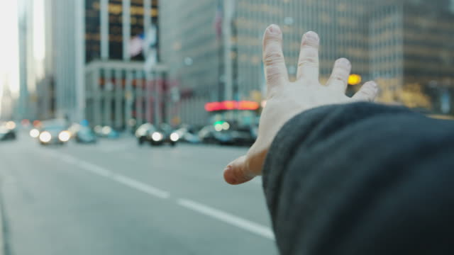 pov male hand arm hailing cap taxi new york city - reaching stock videos and b-roll footage