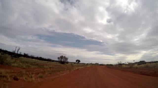 pov of car driving in the australian outback - dirt track stock videos & royalty-free footage