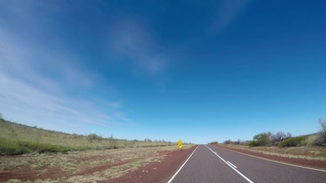 Pov of car driving into the Australian outback