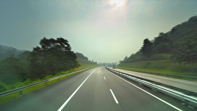 t/l pov of car on dual carriageway to singapore - infinity stock videos & royalty-free footage