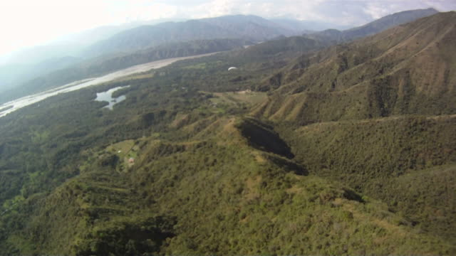 pov of paraglider trailing 2nd paraglider - パラグライディング点の映像素材/bロール
