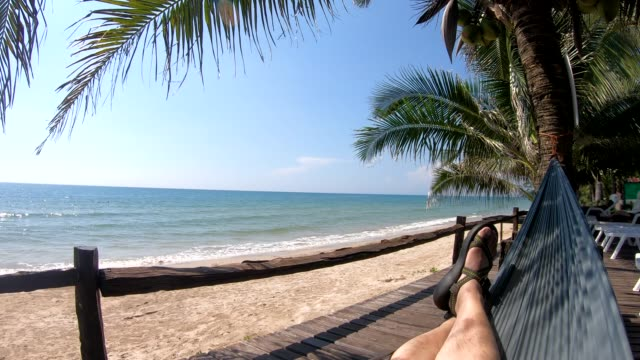 pov of people sleep on hammock with palm tree at sea in evening time - tourist resort stock videos & royalty-free footage