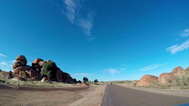Pov of vehicle driving to the Devil's Marbles