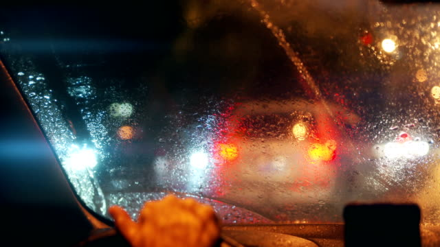 pov through windshield of car at rainy night - headlight stock videos & royalty-free footage
