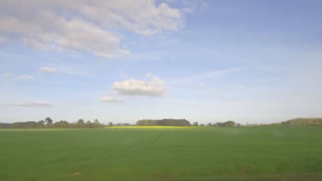 pov train, countryside landscape in brittany, france - zugperspektive stock-videos und b-roll-filmmaterial