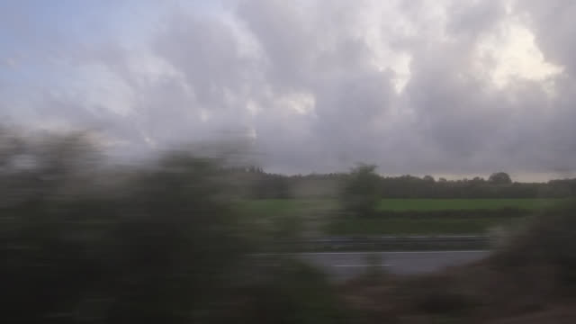 pov train, countryside landscape in brittany, france - overcast stock videos & royalty-free footage