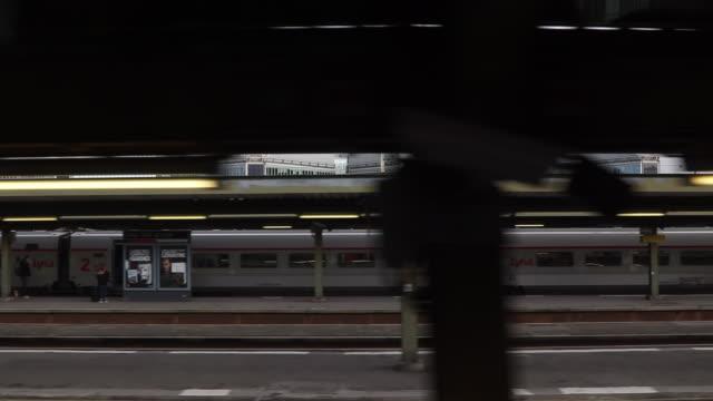 Pov urban landscape seen through window of moving train
