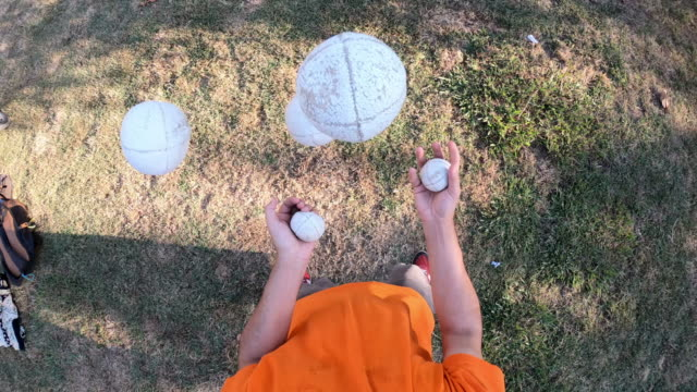 pov view of a juggler performing at the park - juggling stock videos & royalty-free footage