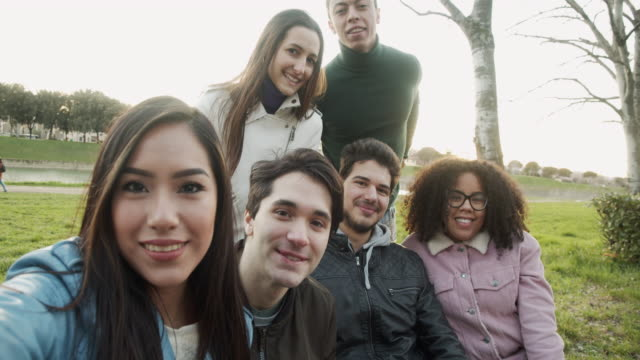 pov view of six friends taking a selfie together outdoor - slow motion video - multiracial group stock videos & royalty-free footage