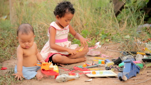 Poverty asian children playing toy