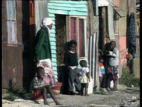 Poverty CF TAPE NO LONGER AVAILABLE DAWN SOUTH AFRICA Cape Town MS Small number of black people towards as travel to work DAY MS Group of blacks...