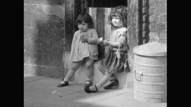 1936 - poverty in london - hanging stock videos & royalty-free footage