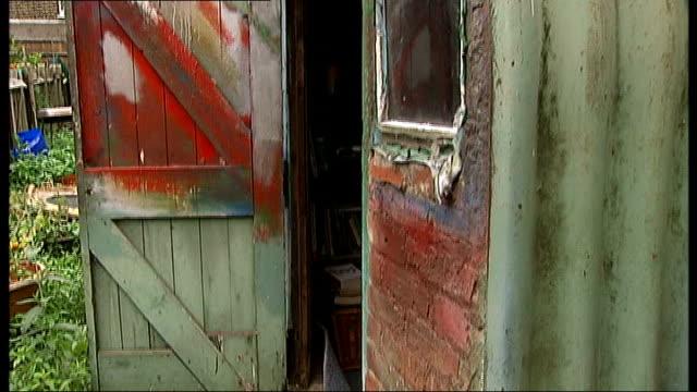 vídeos de stock, filmes e b-roll de london housing shortage: pensioner living in air raid shelter; england: london: lewisham: ext / int various shots of run-down former air raid shelter... - air raid