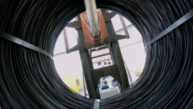 stockvideo's en b-roll-footage met povs steel cable in a warehouse - uk