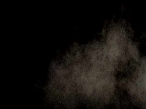 powder explosion in slow motion variation  6 - dust stock videos & royalty-free footage