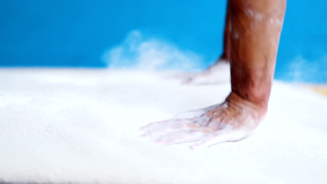 powder talcum on gymnastic vault close up - sbarra da ginnastica video stock e b–roll