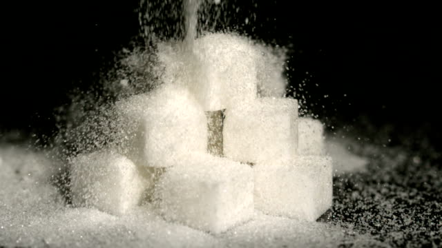 Powdered sugar falling onto cubes