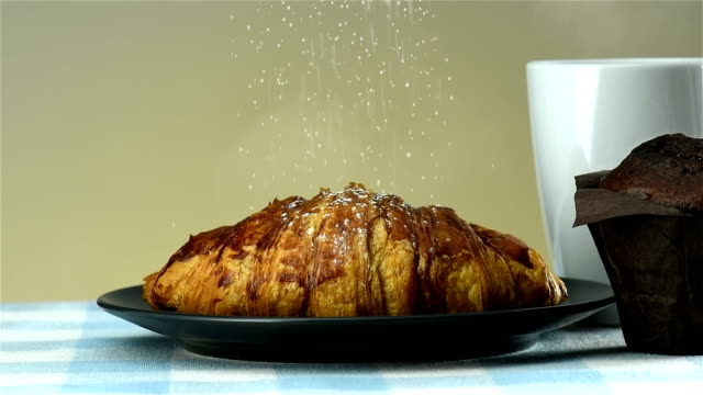 powdered sugar on croissant - 4k resolution - coffee drink stock videos & royalty-free footage