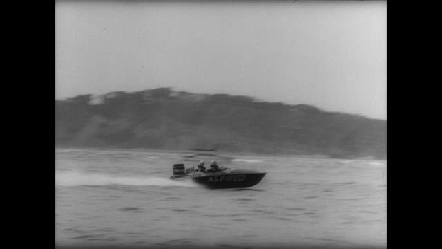 stockvideo's en b-roll-footage met power boats racing across english channel / individual boats / water choppy / tommy sopwith's boat / man lowers checkered flag as sopwith wins /... - alle vlaggen van europa
