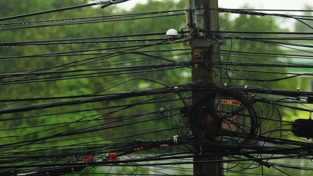 power cable and signal cable with heavy rain. - transformer stock videos & royalty-free footage