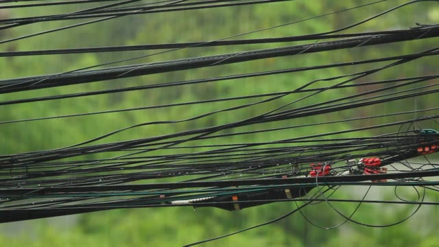 power cable and signal cable with heavy rain. - power line stock videos & royalty-free footage