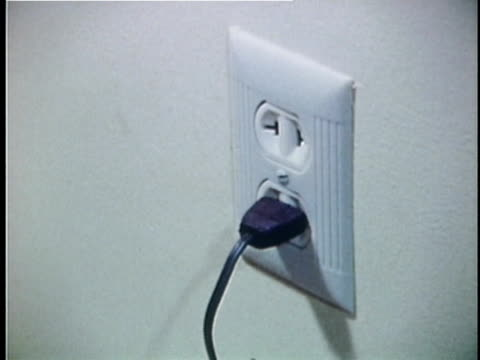 1973 montage power cables appearing in outlet, usa, audio - plug socket stock videos and b-roll footage