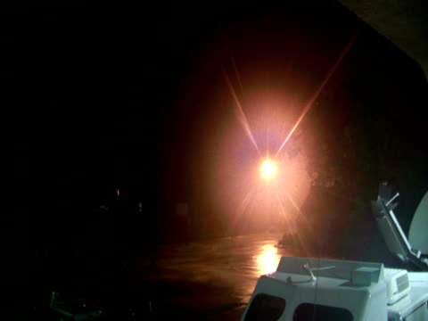 power flashes in distance and close up sparks during hurricane wilma - sparks点の映像素材/bロール
