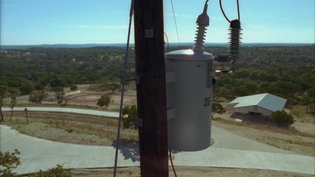 slo mo cs ws power line capacitator and bucket truck driving by / johnson city, texas, usa - johnson city texas stock videos & royalty-free footage