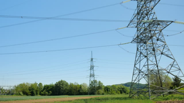 power line with power station in nature - cable stock videos & royalty-free footage