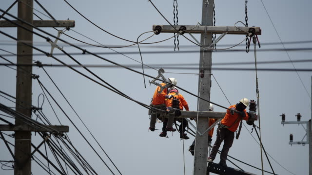 power line workers - electrician stock videos & royalty-free footage