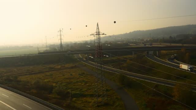 vídeos y material grabado en eventos de stock de antena líneas de potencia por encima de la carretera intersecciones - power line