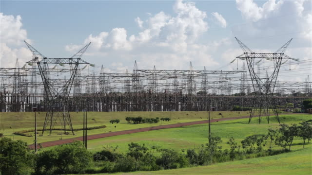ls power lines run from itaipu dam towards ciudad del este / ciudad del este, paraguay - elettricità video stock e b–roll