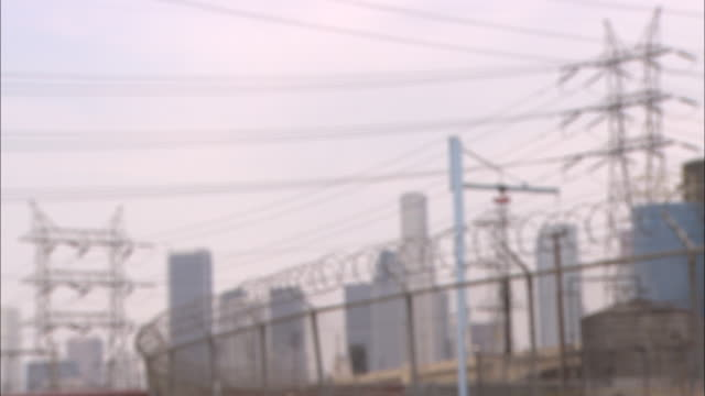 power lines stretch across a power station. - electricity stock videos & royalty-free footage