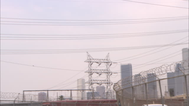power lines stretch across a power station. - transformer stock videos & royalty-free footage