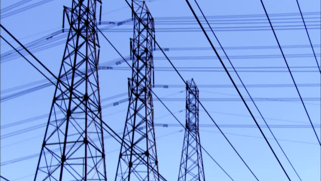 Power lines stretch between electrical pylons, Los Angeles. Available in HD.