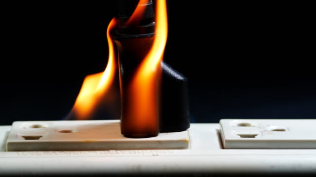 power outlet burning close-up black background - plug socket stock videos & royalty-free footage