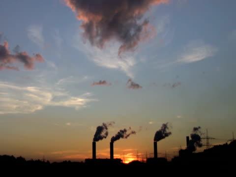 stockvideo's en b-roll-footage met ntsc: power plant at sunset - mens gemaakte bouwwerken
