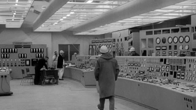 1965 montage power plant control room and workers / united kingdom - kraftwerk stock-videos und b-roll-filmmaterial