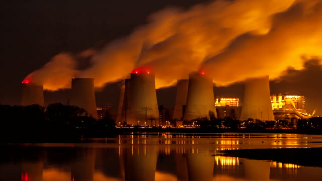 Power plant in the night, time lapse