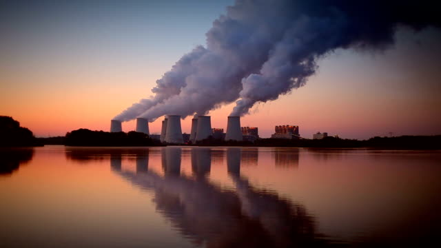 power plant in the sunrise - pollution stock videos & royalty-free footage