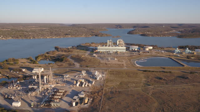 power plant rw miller in palo pinto on sunny day - drone view. the rw miller power plant is one of several plants owned by the brazos electric power... - sunny video stock e b–roll