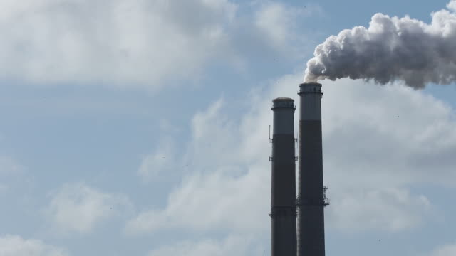 power plant smoke stacks - coal fired power station stock videos and b-roll footage