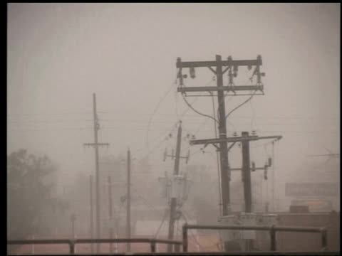 power pylons sway in increasing wind as hurricane katrina approaches gulfport mississippi 29 august 2005 - hurricane katrina stock videos and b-roll footage