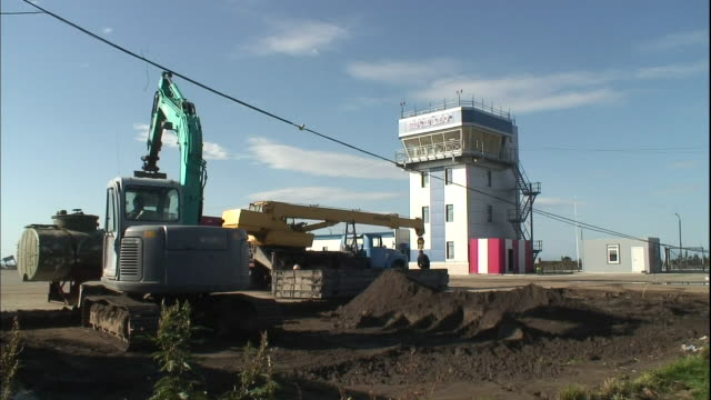 A power shovel digs at a construction site beside the Mendeleyevo Airport on Kunashiri Island.